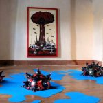 Mines publicitaires, 2016. Dimension au sol : 45 m2. Résine, bouteille de soda, papiers publicitaires, moquette bleue.  Exposition collective au château de Castanet (lozère) avec la Biz'ArtRit